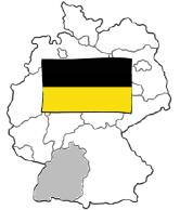 Eine Karte von Deutschland zeigt unten links in grauer Farbe das Bundes-Land Baden-Württemberg mit schwarz-gelber Flagge