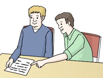 Eine Person erklärt einer anderen Person ein Papier